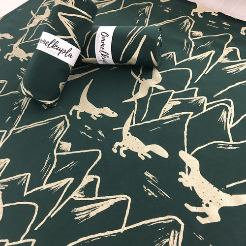 Mountainsaurus, gold print deep green french Terry